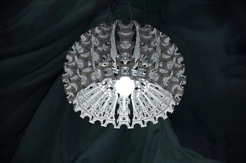 """COLOSSEUM"" big suspended lamp, pays tribute to Eiffel."