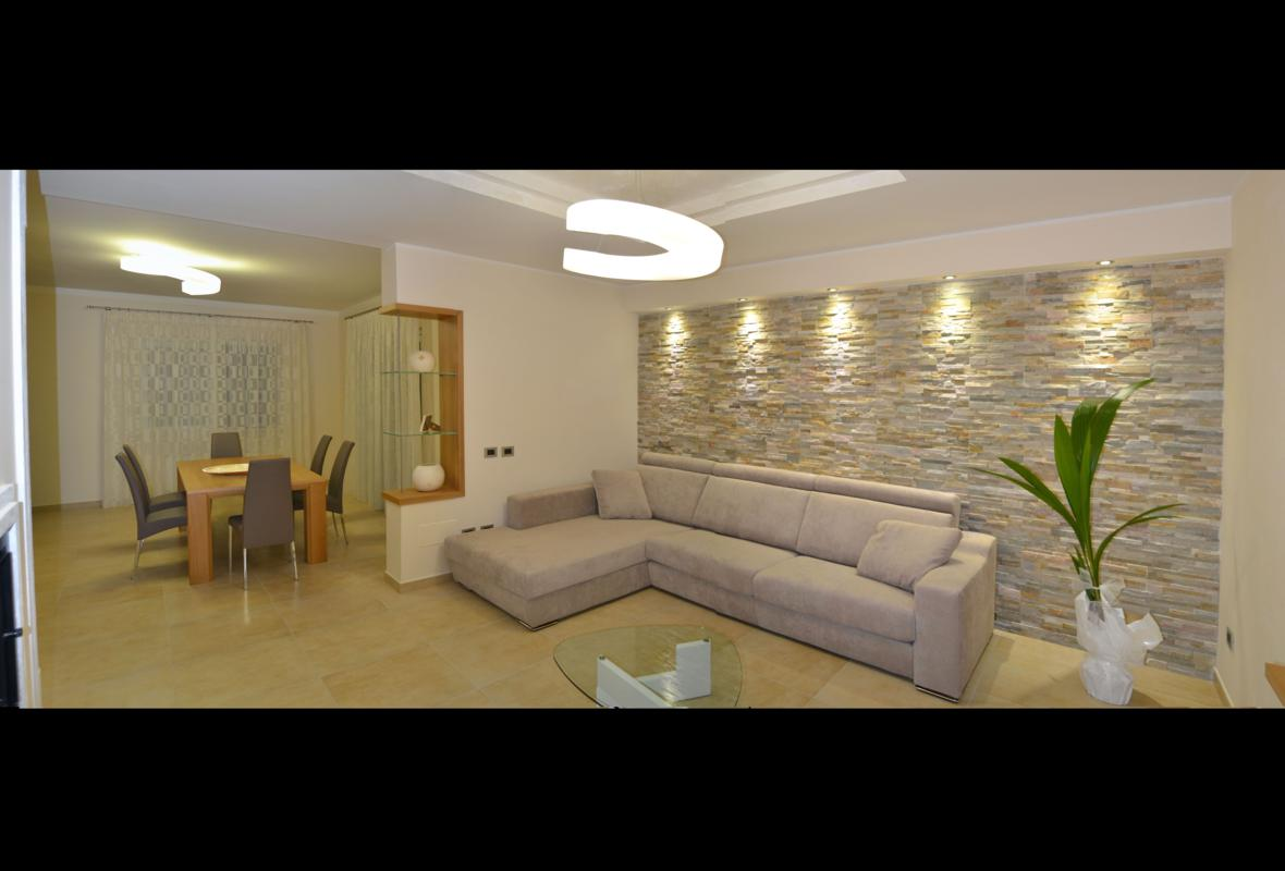 Interio design for Rivestimento parete salotto